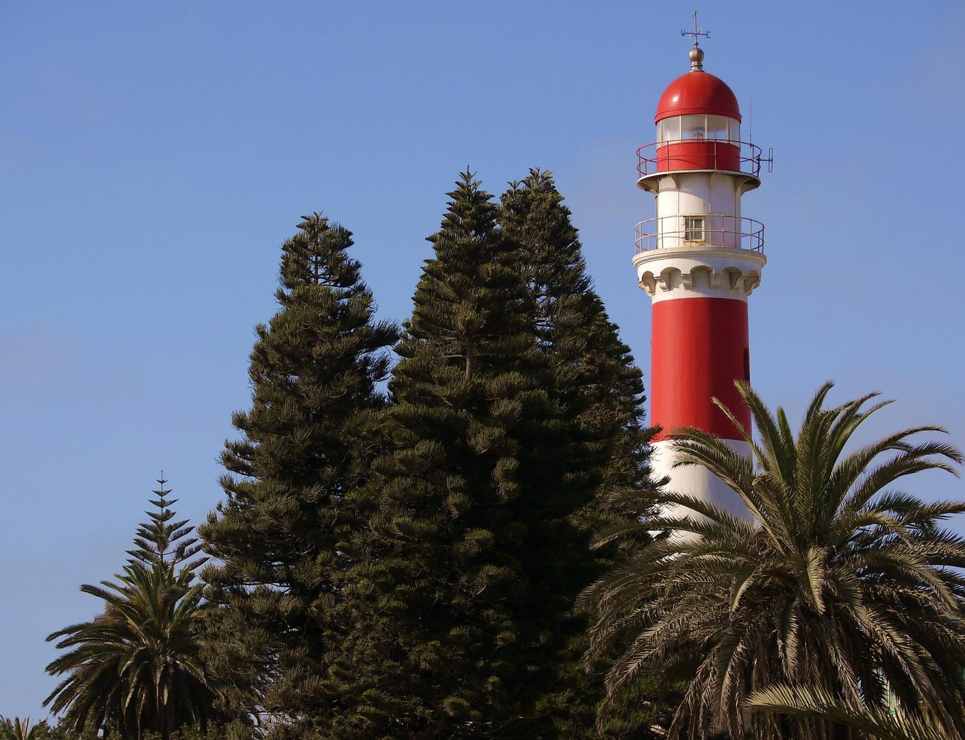 Leuchtturm mit Palme