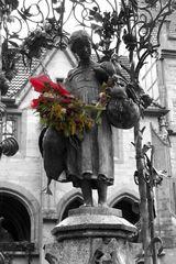 Liesel mit Gaensen und Blumen