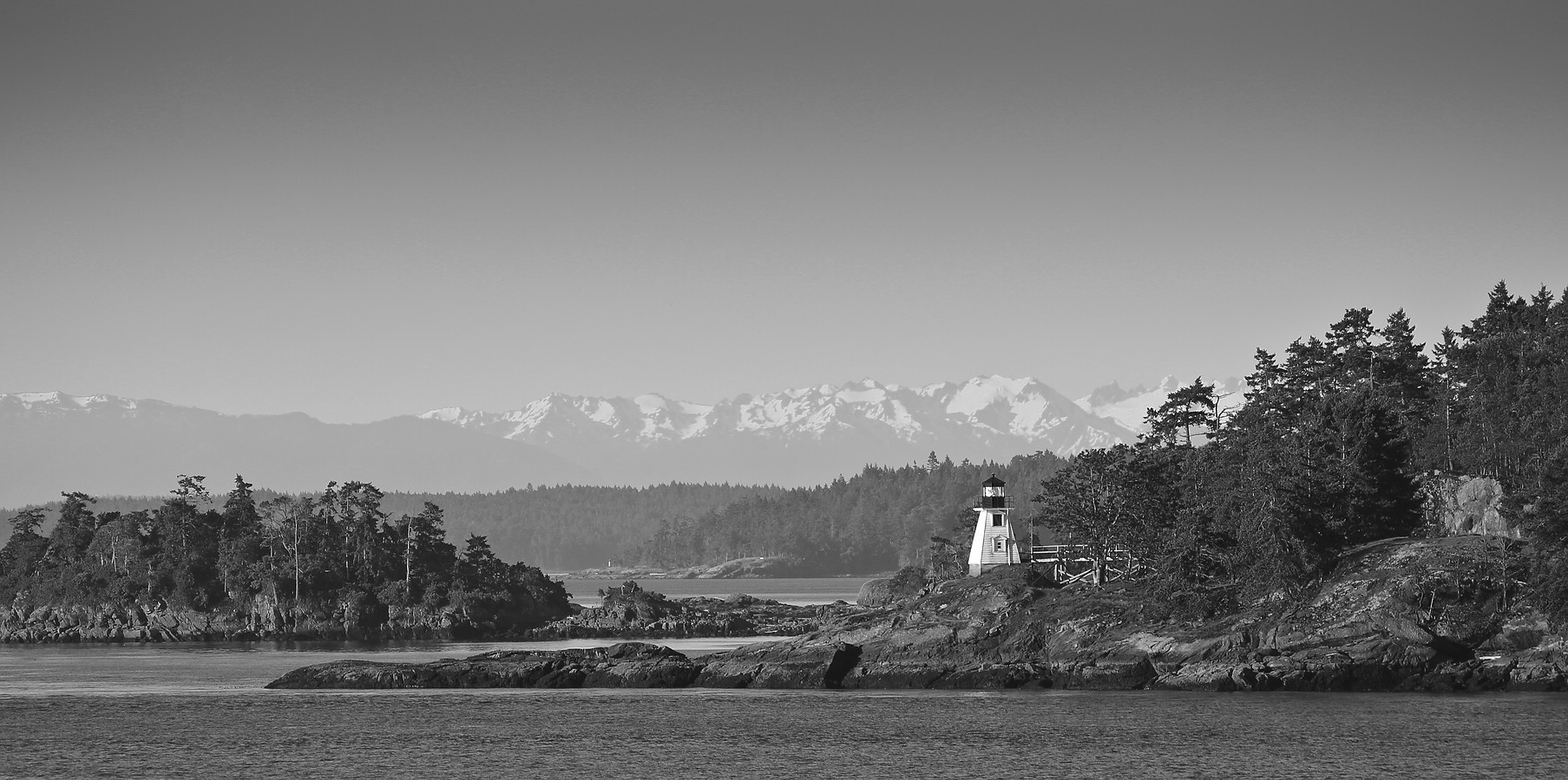 Lighthouse and Olympic Mountains
