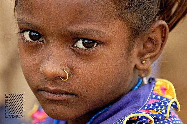 Little girl, big eyes and blue dress