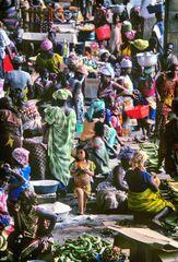 Little white girl on the market in Abidjan
