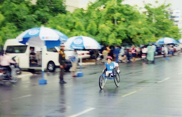 Lonely woman on the wheelchair racing