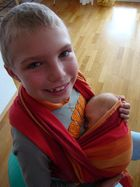 Luc holding Baby Tim