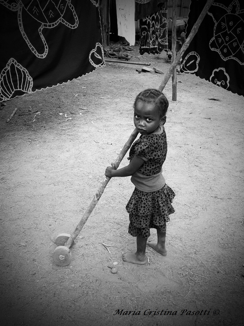 Madagascar - Child with wooden toy