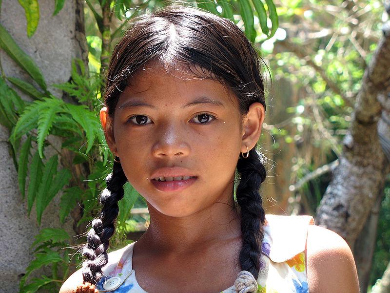 Mädchen auf Mantigue Island, Camiguin vor Mindanao Foto