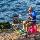 Man Enjoying The Sea smoking Hublebuble and Listening to Music