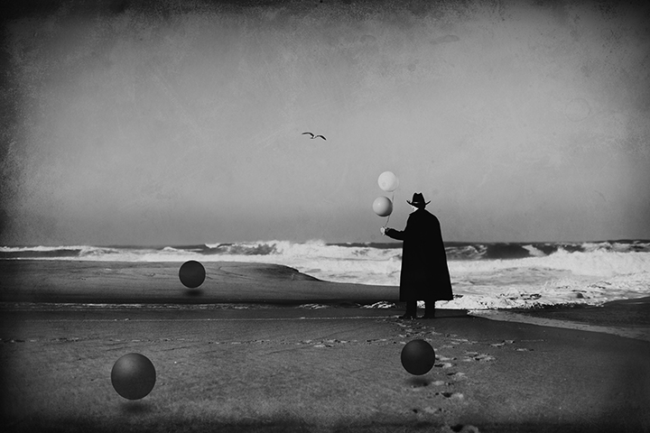 Man in Black at the Beach with Balloons and Spheres #2