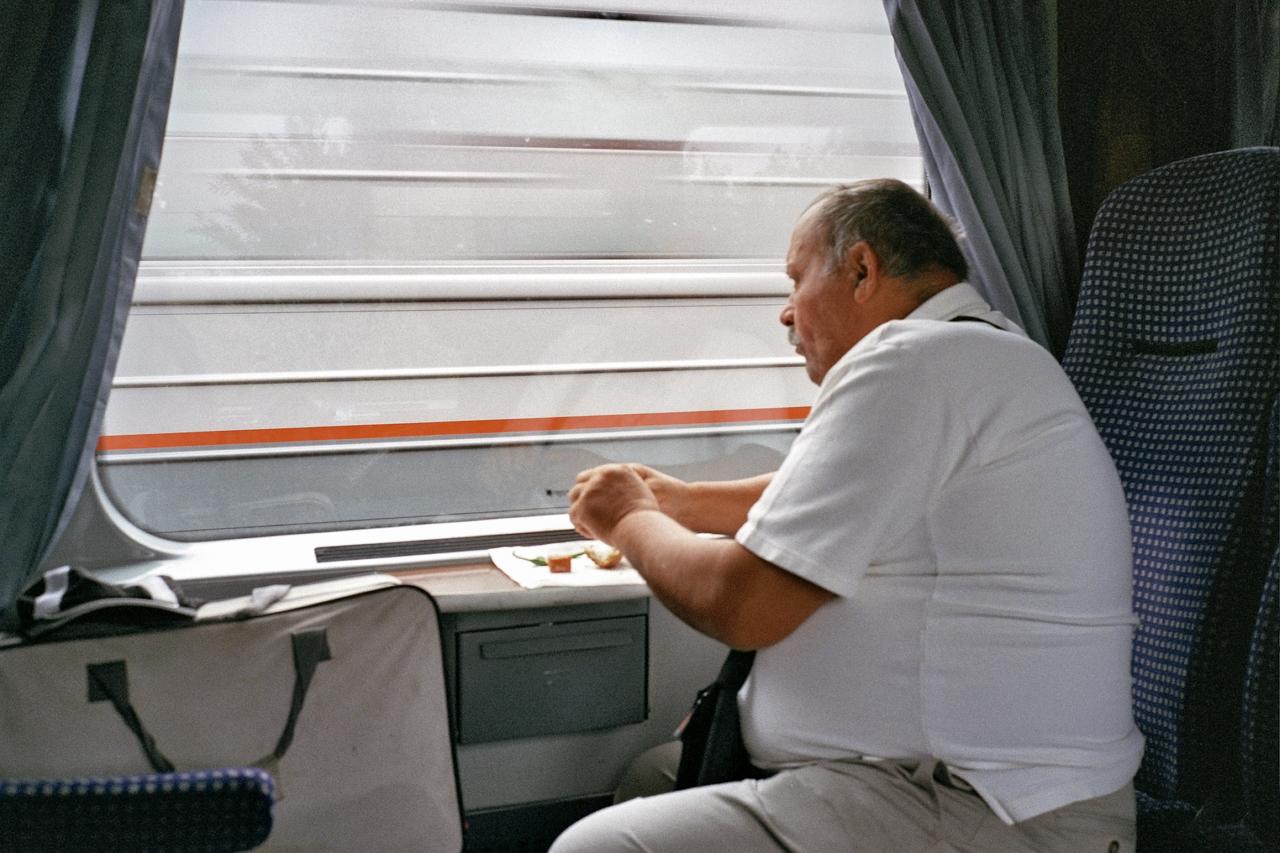man looking on the window