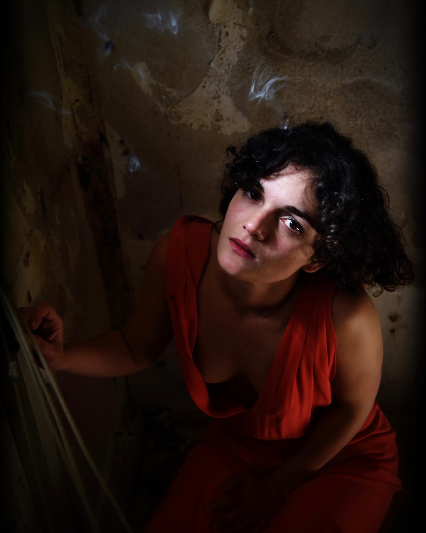 Marta smoking in the cellar