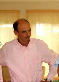 Michael E. Scholti