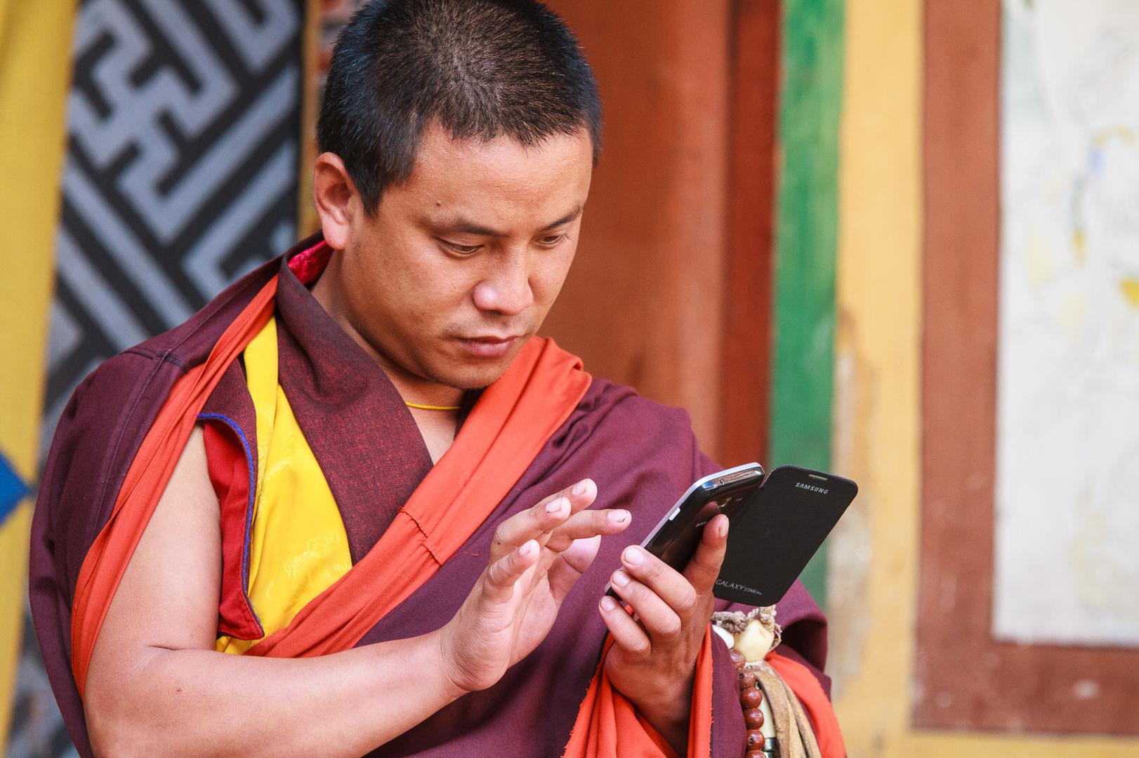 Mönsch mit SmartPhone
