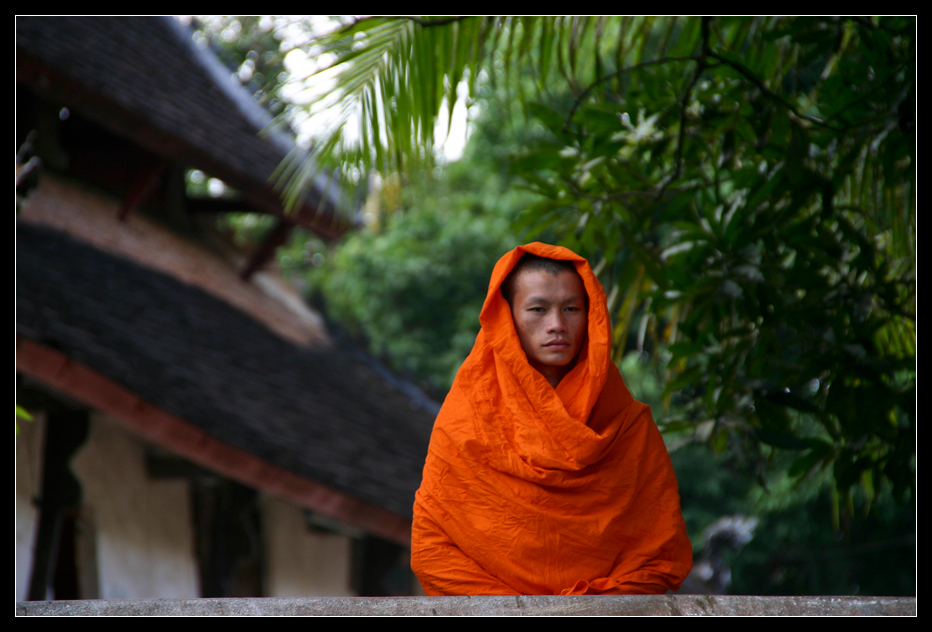 ... monk in a monastery in Luang Prabang ...