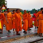 Monks as tourists at the bridge over the River Kwai