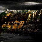 morning rise on Santorini rock