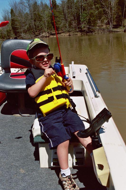 my 2yo fishing with superman fishing pole