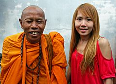 My friend, the monk from Bangkok and the local beauty;-)