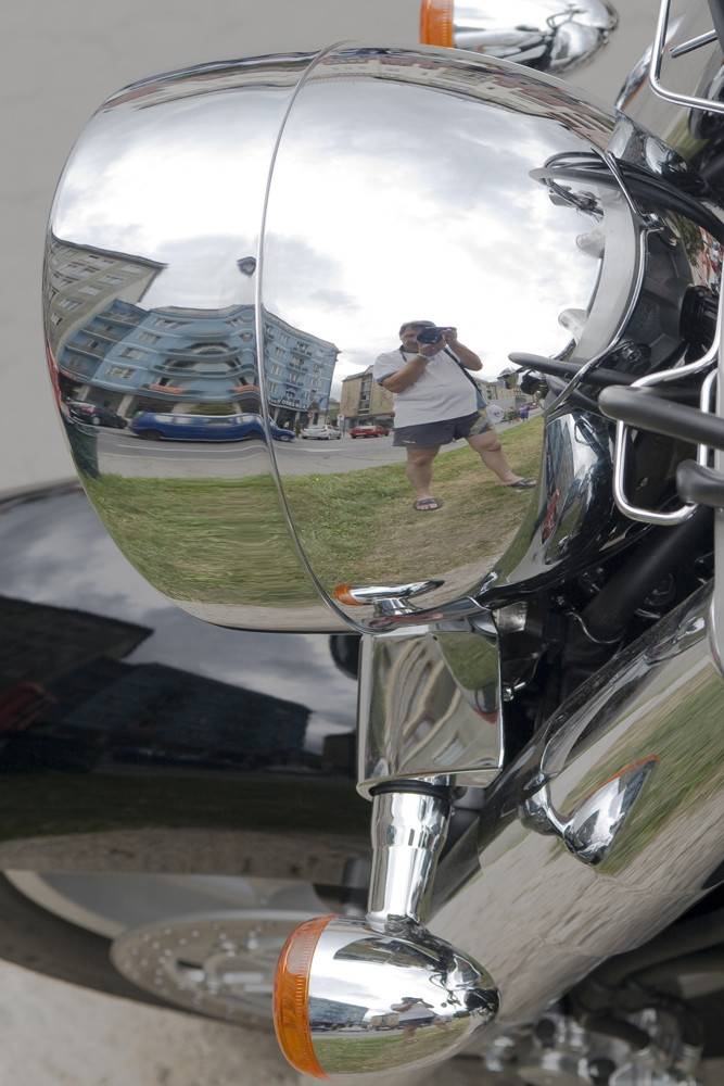 My mirror is my motor-cycle.