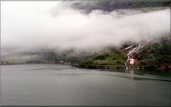 Navigating the fjord with rain