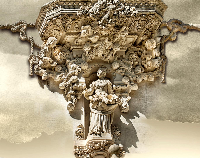 Niña de las palomas. Conjunto escultórico en la fachada del palacio. Quinta da Regaleira. Sintra