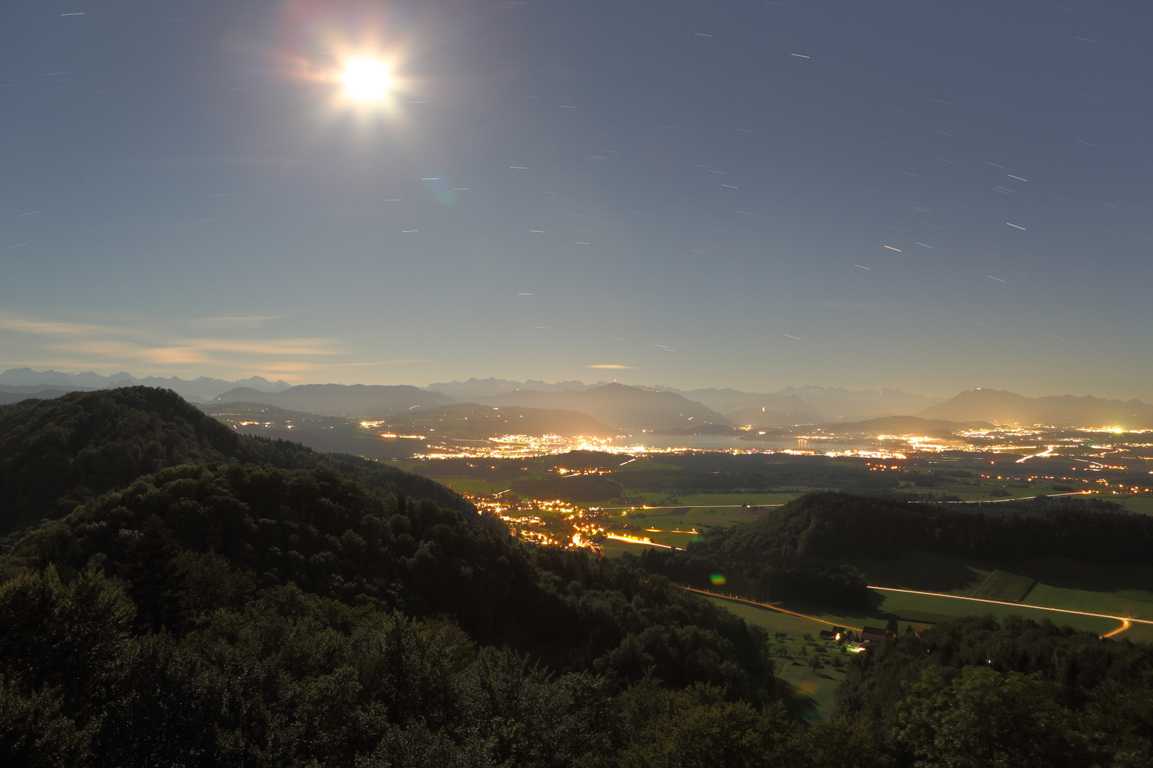 night view with moonshine and stars from Albispass on Zug and mountains (5 minutes exposure)