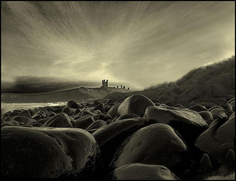 northumbrian coastline showing dunstanburg castle