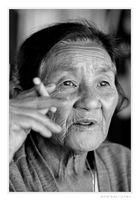 old blind smoking lady