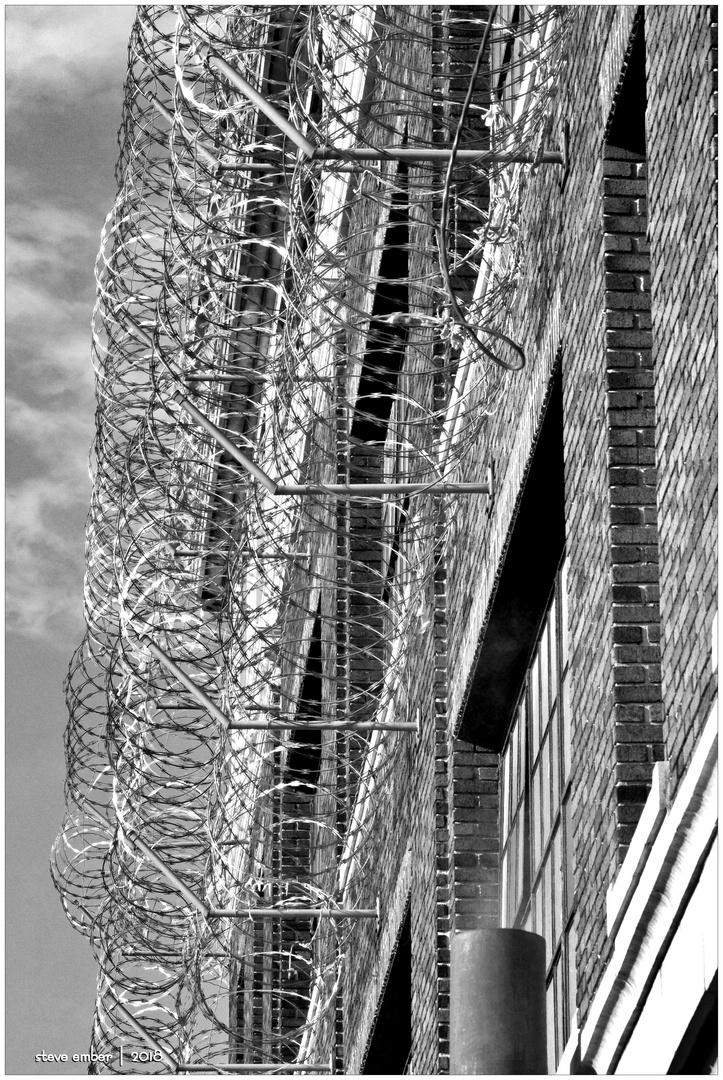 Old Brick and Razor Wire