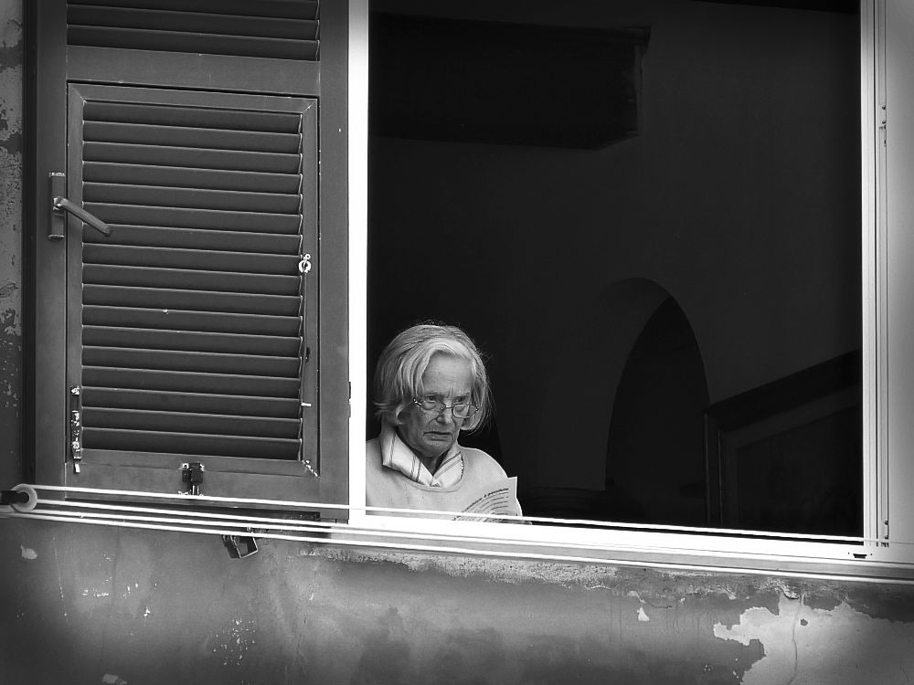 Old signora in the window