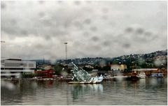 Oslo through the boat window with rain.