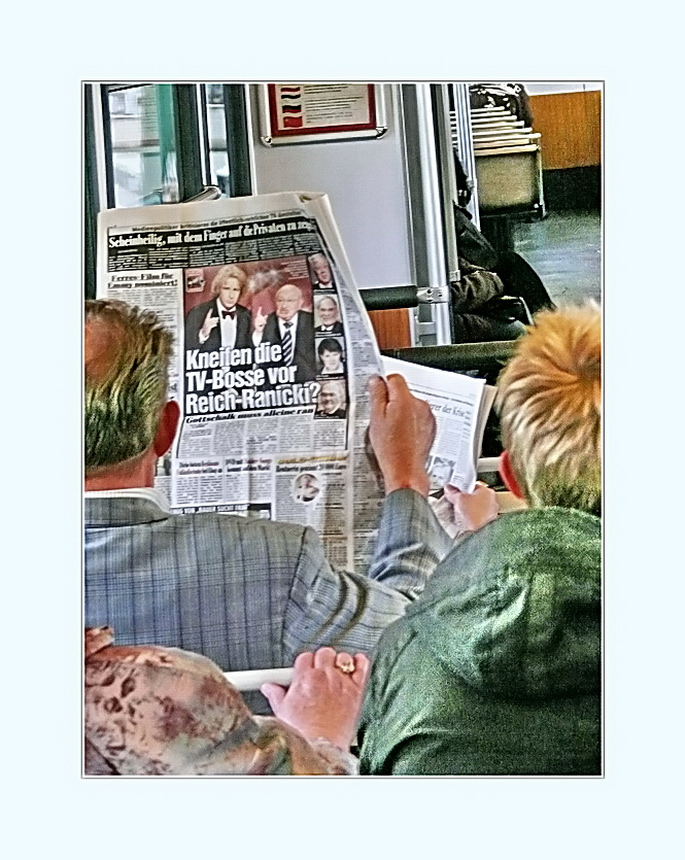 part of a  story, keeping up with the news on the way to work (or is it entertainment?)