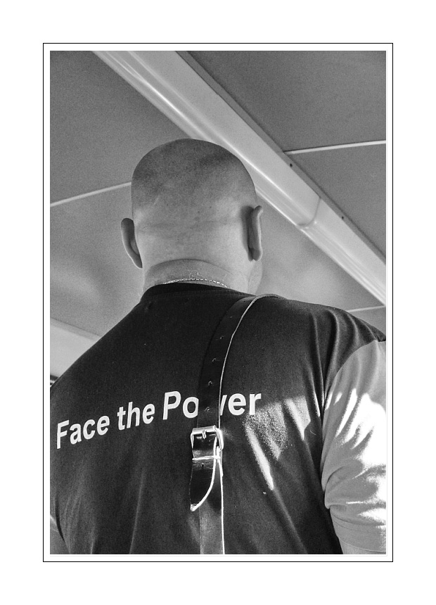 part of a  story, ( my eyes followed the letters on his t-shirt, 'face to ..... )