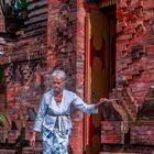 Pemangku woman enters the temple