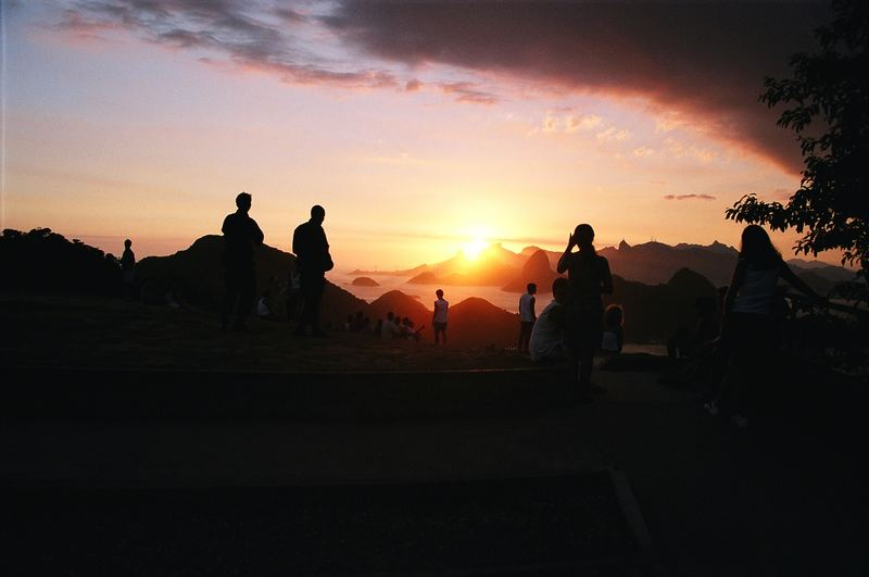 People Watching The Sunset
