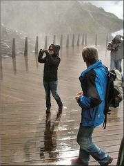 Photografer in the shower at Kjosfoss waterfall.