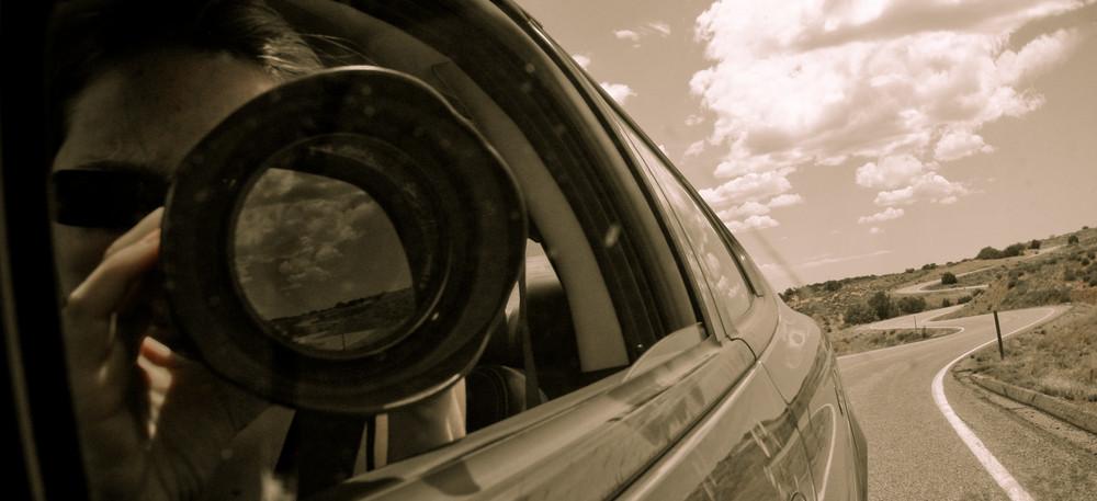 Photographe, voiture et route
