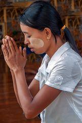 Praying young woman in Shwedagon