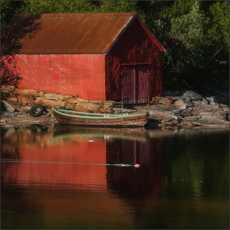 red house with boat