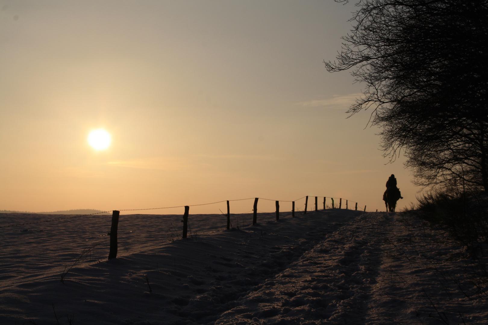 Reiter bei Sonnenuntergang