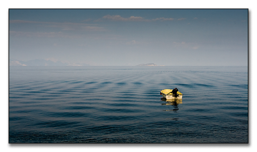 rippels and a yellow boat