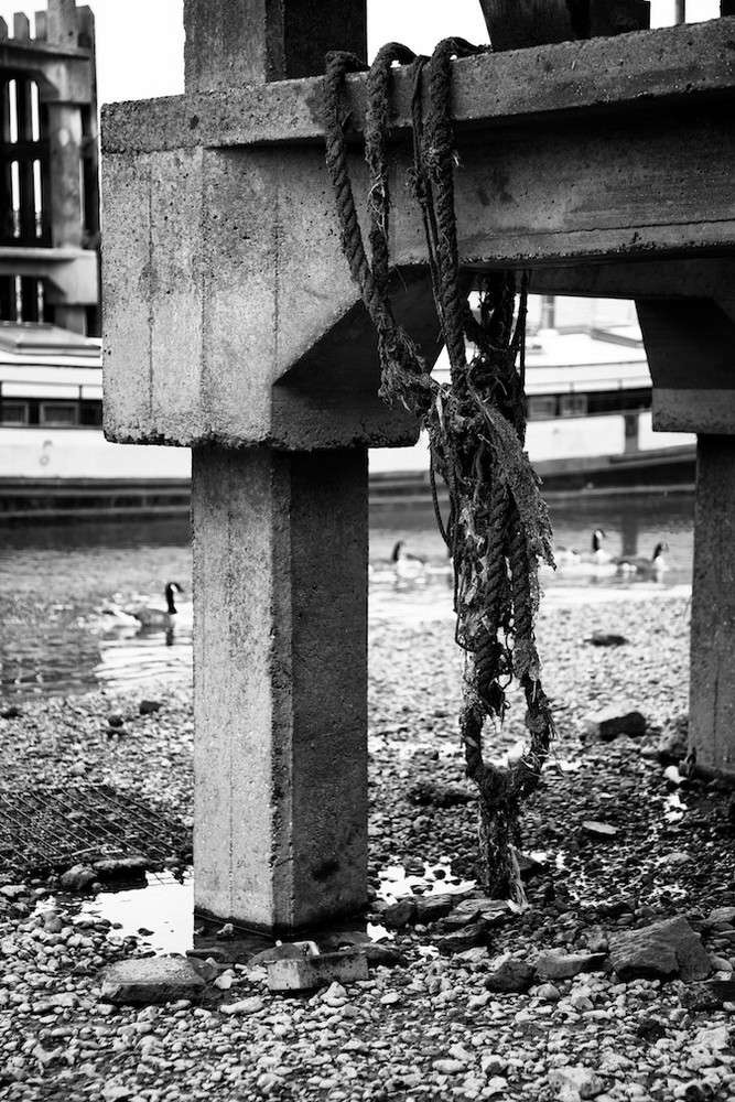 Rope hanging from pier