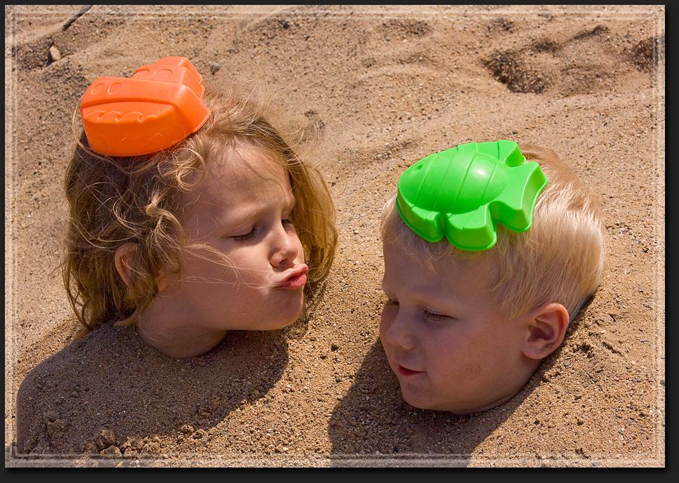 Sand-Köpfe