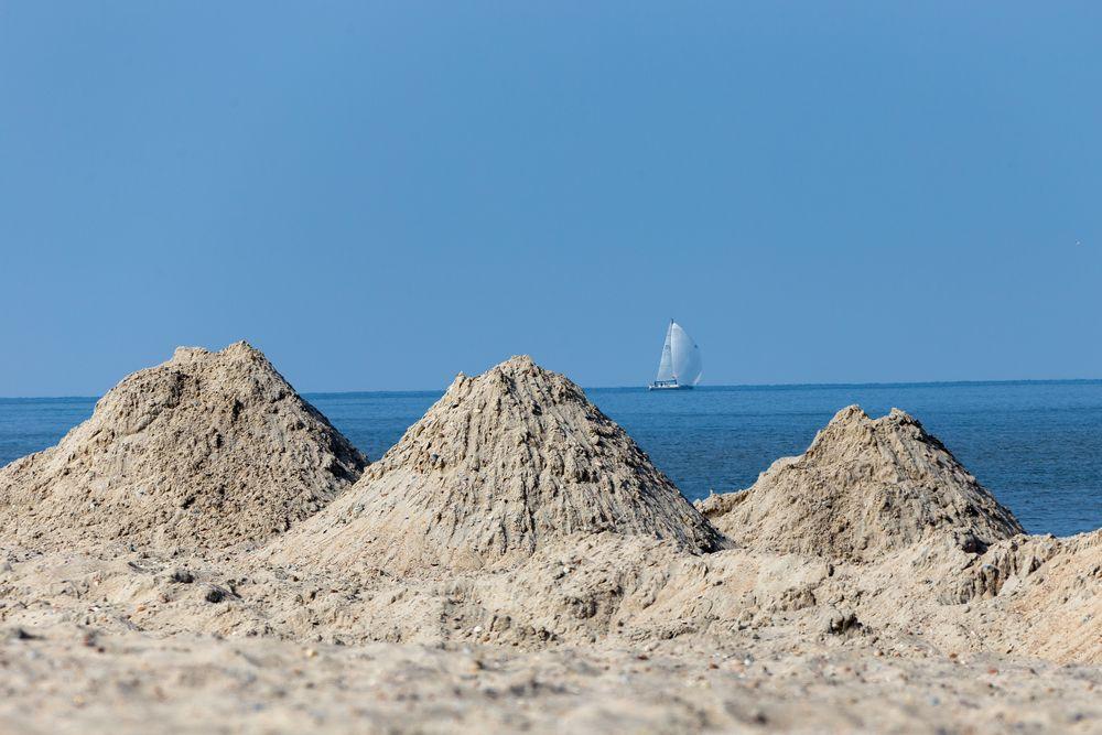 Sandarbeit am Strand