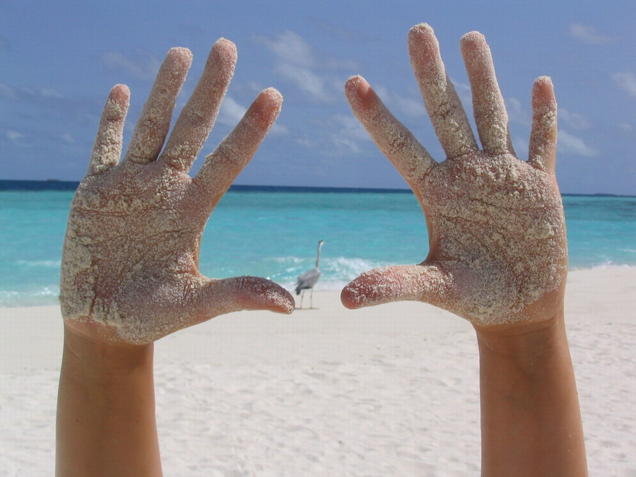 sandige Hände