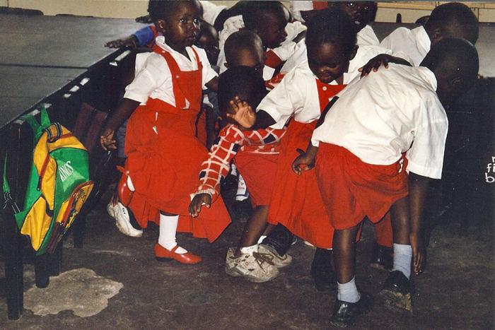 School for street children. Dancing/singing in the classroom