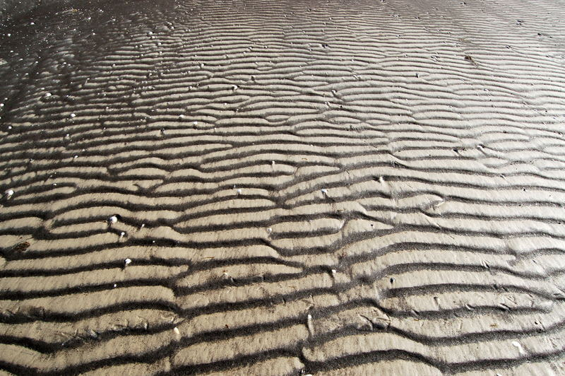 Schwarzer und weißer Sand