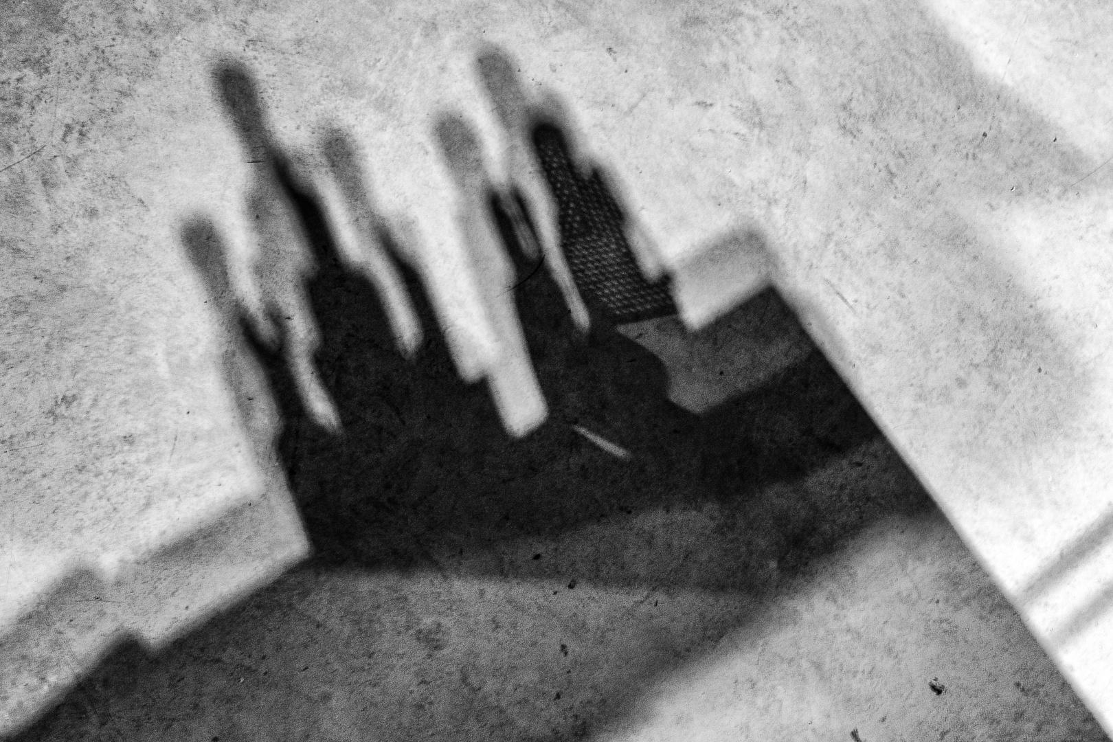 ... shadow-people on  floor ...