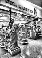 She Lifts Her Lamp Beside the Deli Store...