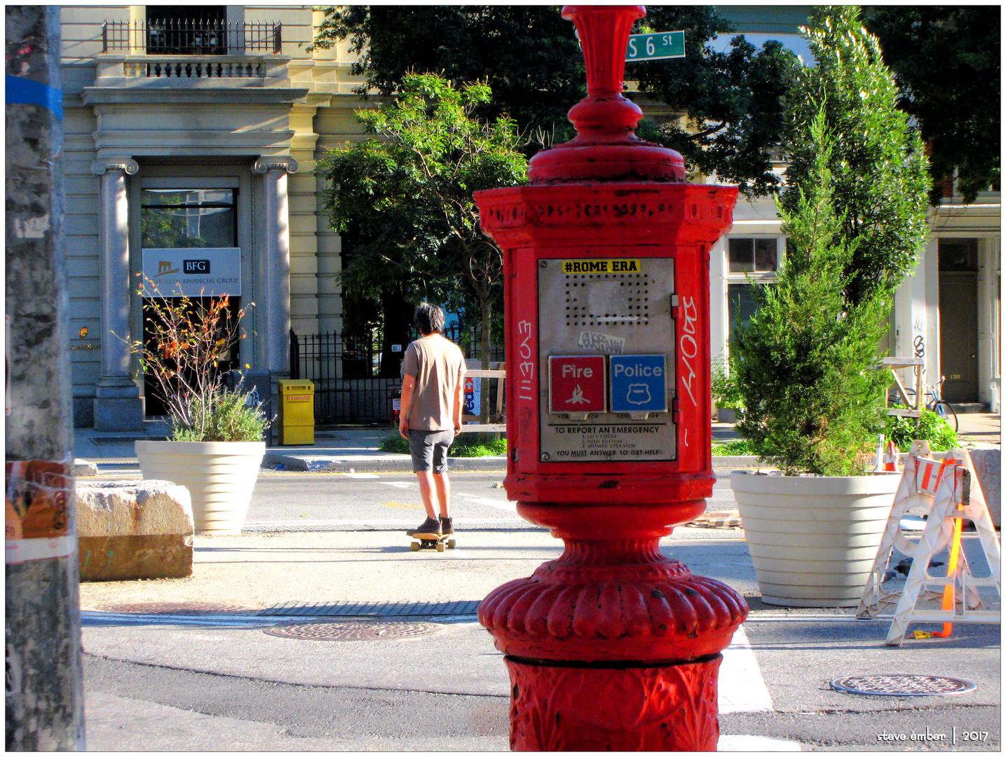 Skateboarder and Callbox - A Williamsburg Moment