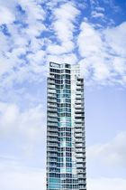 skyscraper with blue sky and clouds