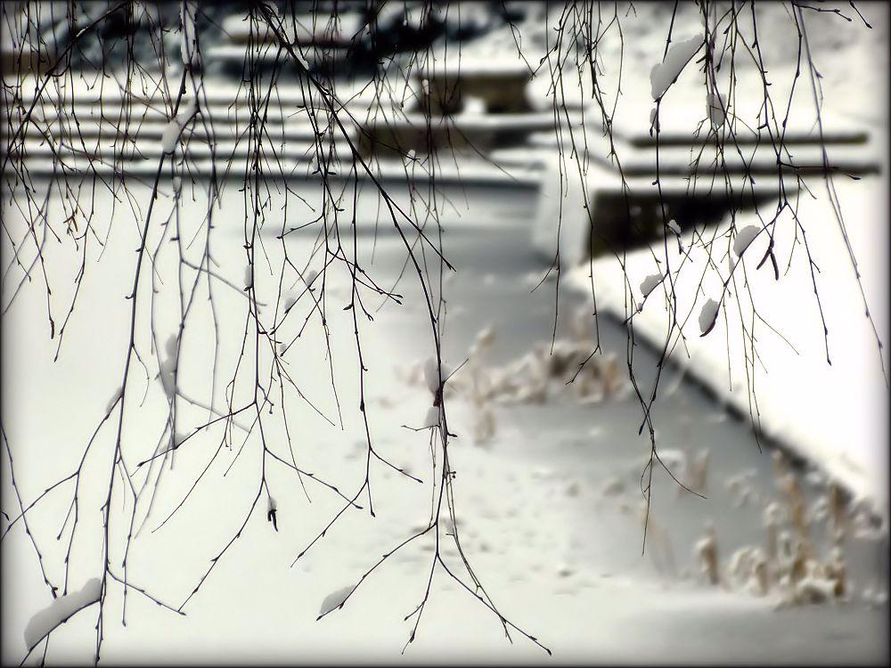 Snow lies on fountain pond
